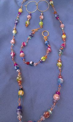 Rainbows and copper necklace earring and bracelet by DoubleDzBeadz, $12.00