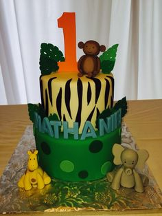 Jungle theme birthday cake with edible animals, Sugarnomics Cake Studio Guam