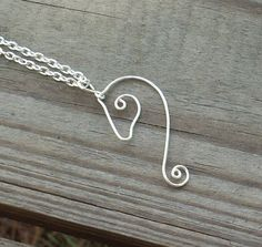 This necklace is made with REAL silver plated copper core 20 gauge wire and silver plated chain.    This necklace makes an excelent gift for any horse lover. Measuring about 2 inches in length and 1 inch in width.