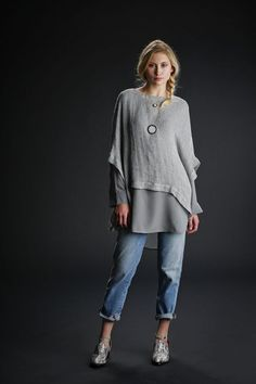 Silk tunic top, $178, under organic linen poncho, $158, and jeans, $178, all Eileen Fisher; www.eileenfisher.com; House of Harlow necklaces $48 (small) and $85 (large); Jeffrey Campbell shoes, $126; all Bloomingdale's.Model:  Mary R. / Look Model AgencyStyling: Maghan McDowellHair/Makeup:  Erika Taniguchi / BeautybyErika.com Photo: Russell Yip, The Chronicle