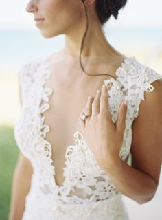 Sexy Embroidered Illusion Neckline Gown: http://www.stylemepretty.com/2014/10/16/romantic-garden-wedding-by-the-water/   Photography: Ozzy Garcia - http://ozzygarcia.com/