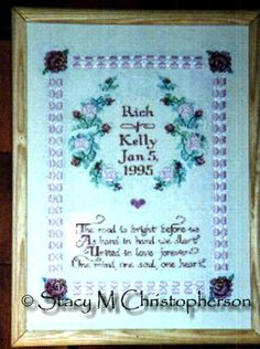 """My finished """"The Road is Bright Before Us"""" Wedding Sampler.  Pattern was in an issue of Cross Stitch & Country Crafts prior to December 1994."""