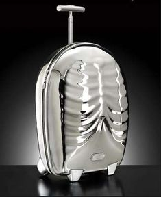 Skeleton Luggage II ~The original version of Samsonite's Hero suitcase was featured back in 2007 but has been reinvented once more. The case, which was designed by avant-garde designer Alexander McQueen, resembles the human torso, with a rib cage and sternum relief on the front and vertebrae configuration in the rear.