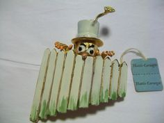 This brooch is one of three Hattie Carnegie fence peekers that I own and will be listing today. This one is of the silly man in top hat with a flower sticking out the top.