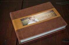 We love how well the cover materials compliment the cameo image with their neutral colors. Image provided by Meaghan Elliott Photography