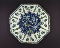 Octagonal Tile Depicting Peacock in Prunus Tree, mid-16th century. Ceramic; fritware, painted in black, cobalt blue, green, and manganese purple under a transparent glaze, 15 1/2 x 1 1/8 in. (39.4 x 2.9 cm). Brooklyn Museum, Gift of Jack A. Josephson, 1990.21. Creative Commons-BY (Photo: Brooklyn Museum, 1990.21_SL1.jpg)