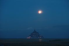 "Lunar Eclipse over Mont Saint-Michel Abbey, rightly named ""The Marvel of the Western World"" is still one of the most famous pilgrimage centres since the Middle Ages"