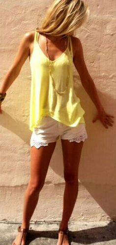 summer outfit with yellow tank and white lace shorts.