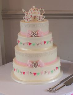 Afternoon tea wedding cake, tea cups, teapot, bunting and bows
