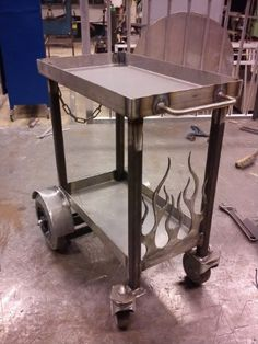 Welding Cart by alutig -- Homemade welding cart featuring a custom-cut flame pattern. Fabricated from square tubing and metal sheet stock. Caster-mounted for enhanced mobility. http://www.homemadetools.net/homemade-welding-cart-10