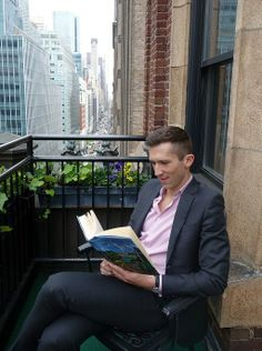 LIBRARY HOTEL's General Manager, Rob Rawlins, is enjoying #GetCaughtReadingMonth! We found him reading a #book on the balcony of the Love Room...his birthday is today so we let him relax a little bit! Even though it's a bit hazy in #NYC, check out that view up Madison Ave. #booklover #libraryhotel #birthday #BookLHC