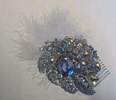 Ambrielle comb. Made using a Butler and wilson brooch and feathers attached to a hair comb.