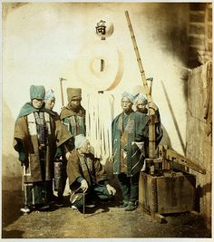 """""""Firemen with their standard."""" ca. 1870s, hikeshi (Japanese fire fighters) with early water pump."""