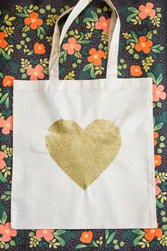 Poppytalk: DIY Gold Glitter Heart Tote Bag  using glitter & mod podge with freezer paper stencil.
