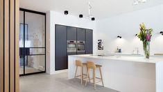 Dark kitchen cabinets, white kitchen island and wooden wall. Design by BNLA architecten Amsterdam. Kitchen Living, New Kitchen, Kitchen Interior, Interior Design Living Room, Kitchen Small, Küchen Design, Floor Design, Wall Design, Rustic Kitchen