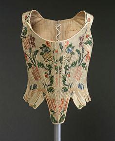Cotilla. 1770-75.Tejido labrado y espolinado de seda, pasamanería de seda y…