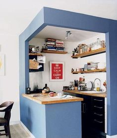 a little blue kitchen - cool ceiling sections off the room without enclosing it.