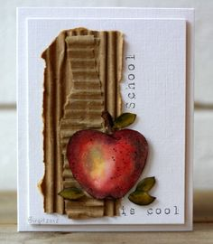 The corrugated and white really offset the apple so well.