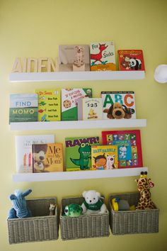 Nursery organization idea: hang woven baskets under the library wall to hold stuffed animals or small toys!