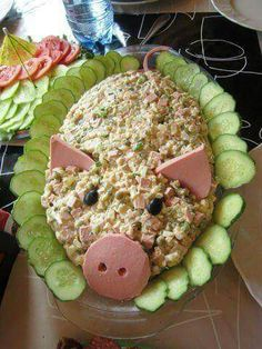 No instructions to this but the picture is worth doing.  Looks easy enough, I'd use potato salad.  Black olives and lunch meat, for pig, and cucumbers for edging.