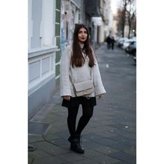 grey jumper and black skirt. by Leticia Neidl