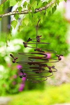 Flamed Bees (Double) Spiral Ornament  Add dimension and allure in your garden or on your patio with this spinning flamed steel ornament.
