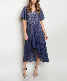 Delight your inner bohemian with this lacy dress crafted out of breathable stretch cotton. Necklace not includedSize S: 54''' long from high point of shoulder to hemModel (wearing size S): 5'9.5'' tall; 32'' chest; 24.5'' waist; 34.5'' hips65% cotton / 35% nylonHand washImported