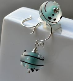 Luxury Solid Silver Earrings Sea Green Handcrafted Glass Beads Turquoise Sea Foam Matt Frost All Solid Sterling Silver Black White Dots Gift. £25.00, via Etsy.