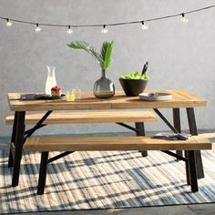 Set out a delectable spread of hors d'oeuvres and snacks at your next backyard barbeque on this understated acacia dining set, or simply set it on the veranda for alfresco family dinners. #snacks #oeuvres #barbeque