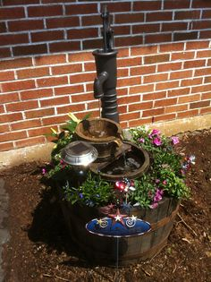 Water Pump Fountain in a Whiskey Barrel.