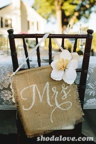 Decorated chairs at a Rustic Wedding #weddingparty #chairs
