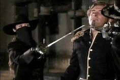 Zorro and his unknown accomplice hold their swords to Montero's throat.