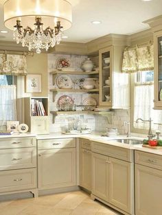 I love this kitchen!  So clean.  Maybe more color in the floral curtains.