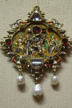 Renaissance pendant depicting allegorical scene with Moses in gold with diamonds, rubies, pearls and enamels.  Late 16th century.  Origin:  Augsburg, Germany.
