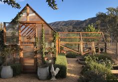 Beautiful chicken coop and chicken run at farmhouse in California. Patina Farm by Giannetti Home