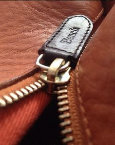 Inset metal zip with leather zip-pull