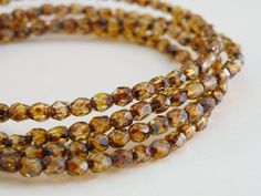 Amber Brown Picasso finish fire polished Czech glass beads by Sparkling Sisters Jewelry Supplies on Etsy, $3.50