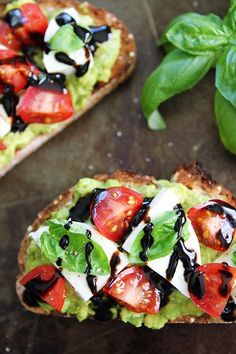 Caprese Avocado Toast Recipe on twopeasandtheirpod.com Caprese salad meets avocado toast! This is the BEST avocado toast and it's good anytime of the day!