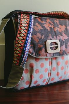 There are so many patterns and textures, both inside and out! The Stefanie satchel makes a great purse or diaper bag for the mom who likes to have a unique flair in her style.