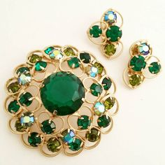 Check out this item in my Etsy shop https://www.etsy.com/listing/258102144/emerald-green-rhinestone-pin-earrings