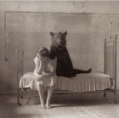 What kind of dog is this? It looks like a bear, except for the tail!    Original captions: My favorite picture from an odd assortment of odd black and whites.