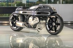 BMW has given world champion custom bike builder Fred Krugger a heavyweight K1600 tourer to customize. The result is straight out of the movie Tron.