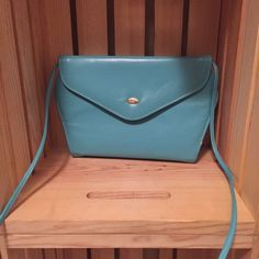 Vintage Teal Crossbody In amazing vintage condition this patent Tiffany blue structured crossbody is definitely a show stopper.  Vintage Bags Crossbody Bags