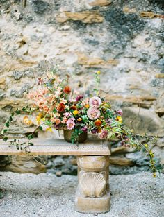 romantic wedding flowers - photo by Charla Storey http://ruffledblog.com/architectural-san-antonio-mission-wedding-inspiration