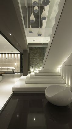 This minimalist modern three storey single family house is located in a residential area of a traditional industrial town which near by a stream in Kaohsiung, Taiwan. Considering the fact that the. Home Stairs Design, Home Building Design, Dream Home Design, Modern House Design, Modern Exterior House Designs, Modern House Facades, Modern Minimalist House, Interior Staircase, House Design Photos