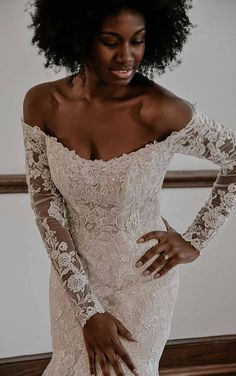 Lace mermaid style wedding dress with off the shoulder neckline and long sleeves for the romantic and sophisticated bride | Essense of Australia Wedding Dresses Spring 2020 - Belle The Magazine | See more gorgeous bridal gowns by clicking on the photo