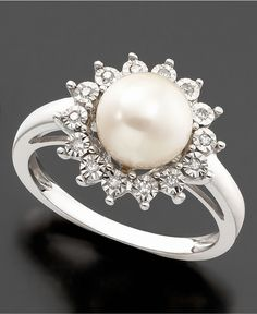 Pristine style with a pretty setting. This lovely ring features a beautiful cultured freshwater pearl (8-8.5mm) and round-cut diamond accent set in 10k white gold.   Photo may have been enlarged and/o
