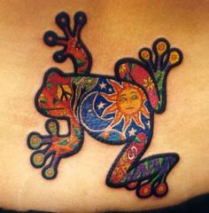 awesome colorful frog tattoos | Frog tattoos could be incorporated within a scene that is representing peace and harmony such as a pond with a frog on a leaf or part of a jungle scene tattoo design. tattoocreatives.com
