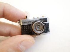 OLYMPUS camera necklace.