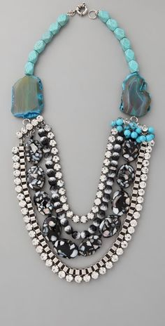 Lee Angel Jewelry Chantal Turquoise Necklace- Turquoise, glass, and acrylic beads. This tiered, beaded necklace features polished agate stones, rhinestone strands, and a box-chain strand. Ring clasp. 26″ (66 cm) long. Oxidized silver-plated hardware.